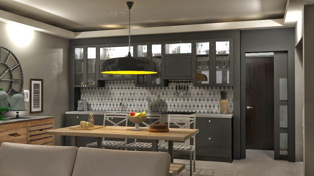 Μια κουζίνα αρκετά metropolitan προσφέρει ένα glamorous αποτέλεσμα στο διαμέρισμα αφού βρίσκεται στο κέντρο του καθιστικού. Τα έπιπλα που την συμπληρώνουν, τραπεζαρία, καθίσματα και μπουφές σχεδιάστηκαν ειδικά για το χώρο και την αποθήκευση κρασιών. Λακαριστές επιφάνειες σε σκούρο γκρι που κρύβουν τον απορροφητήρα αλλά αφήνουν την πλάτη της κουζίνας να στολίζεται με το ίδιο πλακάκι από πάνω έως κάτω. Έτσι η κουζίνα δεν επιβάλλεται στο χώρο ως μαγειρίο αλλά ως διακοσμητικό στοιχείο-έπιπλο.